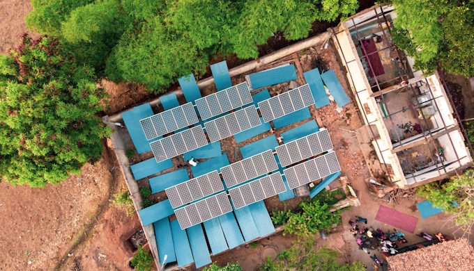 A drone shot of the solar powerhouse under construction. Newly painted roofing sheets dry among the solar panels (Photo by Ajaya Behera)