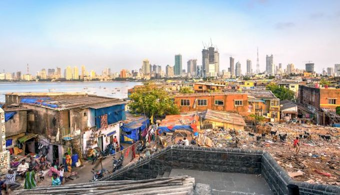 More than 1 billion people live in slums and informal settlements worldwide, concentrated in developing cities like Mumbai (Photo by Adrian Catalan Lazar)