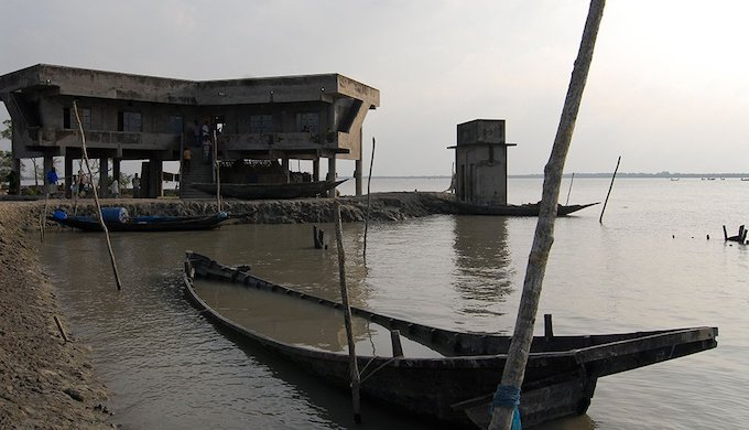 Cyclone shelter at Kalabogi village, in the Khulna division of Bangladesh, close to the Bay of Bengal coast; the shelters are typically built on stilts so that livestock can be housed at the ground level (Photo by Alamy)