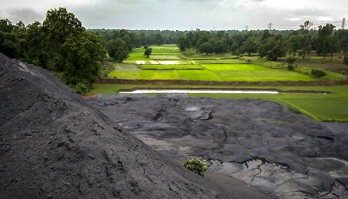 Coal ash dumped by power plants on agricultural land in Gharghoda, Chhattisgarh (Photo by Manshi Asher)
