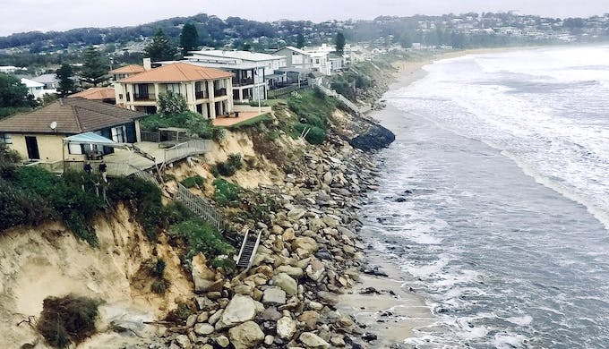 Storms pummelling the New South Wales coast in Australia have left beachfront homes on the verge of collapse (Photo by Darren Pateman/AAP)