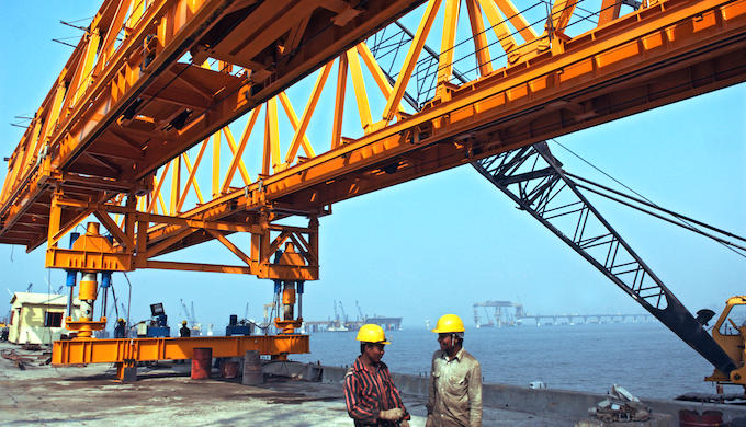 Construction at Bandra Worli Sea Link bridge. Infrastructure development is often linked to biodiversity loss (Photo by Alamy)