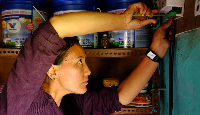 Local residents are trained to take care of the solar microgrids in the remote hamlets (Photo courtesy: Great Himalayan Expeditions)