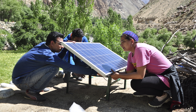 Setting up a solar panel in a Ladakhi village (Photo courtesy: Great Himalayan Expeditions)