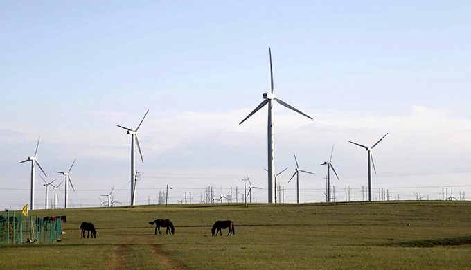 Wind turbines generate electricity in Ulanqab, Inner Mongolia (Photo by Alamy)