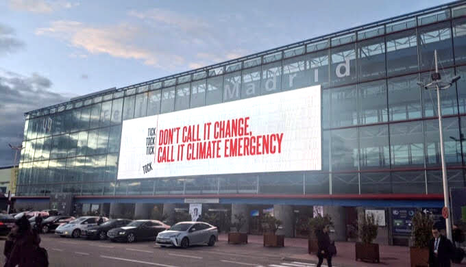 A billboard at the venue of the United Nations climate summit held in Madrid in 2019 (Photo by Soumya Sarkar)